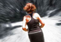 Photo: Back view of a woman wearing a black sports singlet and pants, running.