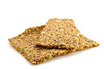 Photo: Two pieces of seeded crackers.
