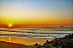 Photo: Sunrise over the beach.