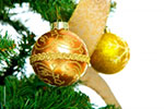 Photo: Gold Christmas baubles.