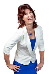 Photo: Woman in a white blazer and blue dress.